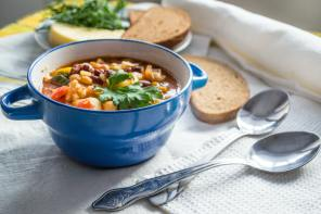 bowl-of-soup-and-two-silver-spoons-1703272