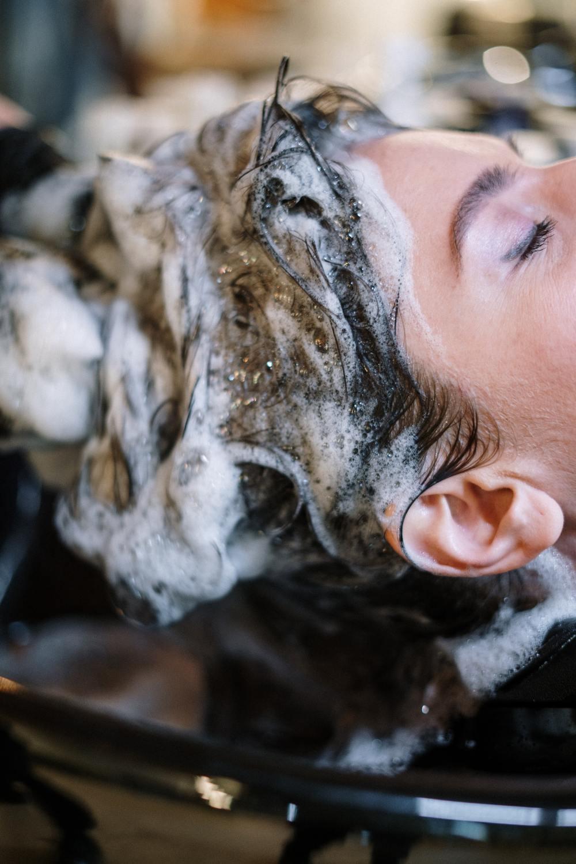woman-getting-her-hair-shampoo-3993461